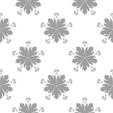 Gray floral pattern on white. Seamless background. Light gray floral ornament on white. Seamless pattern for textile and wallpapers Stock Photography