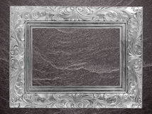 Gray frame Vintage photo frame on marble stone wall background Stock Photo