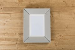Gray frame on wooden background royalty free stock image