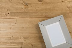 Gray frame on wooden background royalty free stock images