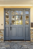 Gray Front Door To A Home With Shale Porch