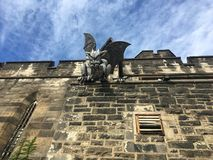 Gray Gargoyle. Gargoyle on Eastern State Penitentiary stone wall, Philly, Pennsylvania, USA Stock Photos
