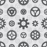 Gray gears seamless pattern. Against the light-gray background. The layout is fully editable Stock Images