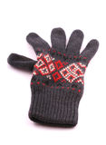 Gray glove. Gray woolen glove with white and red ornaments on white background Royalty Free Stock Images
