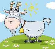 Gray goat on a hill. Goat cartoon character on a hill with flowers and sun and clouds above it Royalty Free Stock Image
