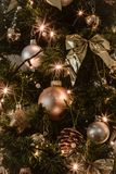 Gray and Gold Baubles Hanging on Christmas Tree
