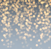 Gray and golden luminous background. Royalty Free Stock Images