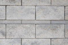 Gray granite brick wall Stock Photo