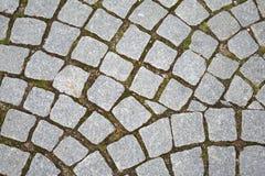 Gray granite cobblestone pavement Royalty Free Stock Images