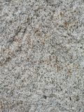 Gray granite stone texture. Granite stone texture of light and dark gray tones and brown spots stock images