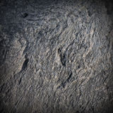 Gray granite texture. Close-up relief texture of gray granite stone Royalty Free Stock Photos