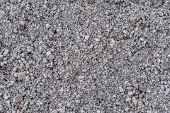 Gray gravel as building material for road construction and road construction as texture stock images