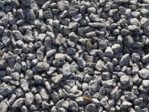 Gray gravel background - small stones. Stone aggregate. royalty free stock image