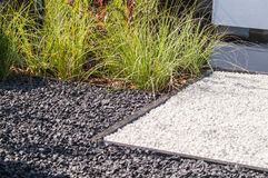 Gray gravel with grass in the design Stock Photos