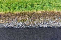 Gray gravel and green grass pattern Royalty Free Stock Images