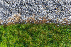 Gray gravel and green grass pattern Stock Photography