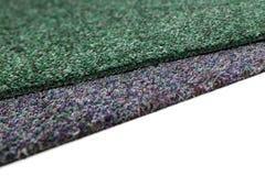 A gray and green carpet Royalty Free Stock Photos