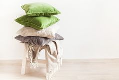 Gray and green cushions, throw. cozy home royalty free stock images