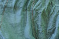 Gray green fabric texture of a crumpled piece of cloth royalty free stock photos