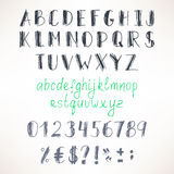 Gray and green hand-drawn font Royalty Free Stock Image