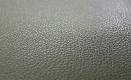 Gray-green leather background surface structure royalty free stock image