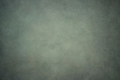 Gray green painted canvas or muslin backdrop Stock Image
