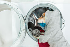 Gray grey hoodie sweater dog back closeup put clothes to washing machine. stock image