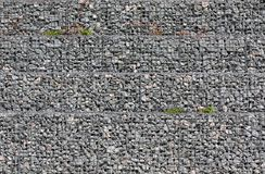 Grey ground stone rubble background of many small stones royalty free stock images