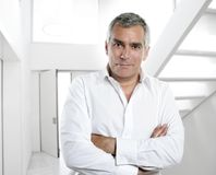 Gray hair businessman interior white office. Senior expertise gray hair businessman posing interior white modern office Royalty Free Stock Photo