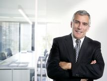 Gray hair businessman interior white office Stock Photos