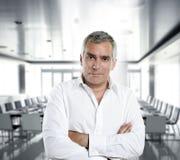 Gray hair businessman interior white office royalty free stock photos