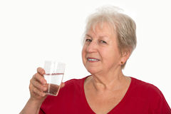Gray-haired is drinking water Royalty Free Stock Photography