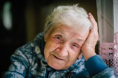 Elderly woman portrait looking at the camera. royalty free stock images