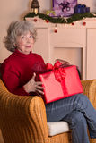 Gray haired woman gift Christmas Royalty Free Stock Photos