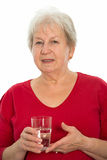 Gray-haired woman with water glass Stock Photo