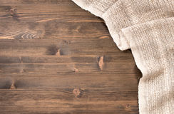 Gray handmade tablecloth from right side of wooden table Stock Images