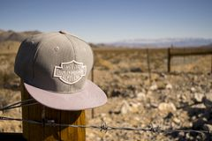 Gray Harley-davidson Motorcycles Flat-brimmed Cap Hanged on Brown Wooden Fence With Gray Barb Wires Stock Images