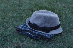 Gray hat with bow and scarf. Royalty Free Stock Images