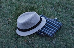 Gray hat with and scarf. Royalty Free Stock Photography