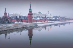 Gray haze of winter. A gray haze over the winter Moscow Kremlin and its reflection in the Moscow River Royalty Free Stock Photos