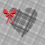 Gray heart with a red bow. On a grey background Stock Images