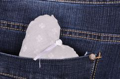Gray heart shape in jeans pocket Stock Photos