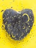 Gray Heart Under The Glass Arkivbild