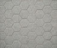 Gray hexagon stone tiles for interiors. They are used mainly for bathrooms, on wall or on floor.  royalty free stock photos