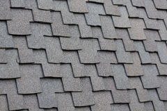 Gray high quality shingles on steep pitch roof Stock Photos