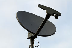 Gray Home TV Dish Against Blue Sky Royalty Free Stock Photography