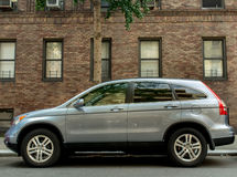 Gray 2012-2013 Honda CR-V. Parked in front of brick building Royalty Free Stock Images