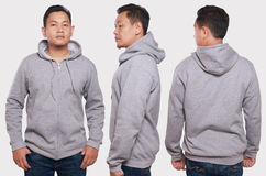Gray Hoodie Mock up. Blank sweatshirt mock up, front, back and side view, isolated. Asian male model wear plain gray hoodie mockup. Hoody design presentation Royalty Free Stock Image