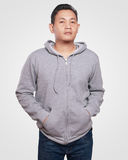 Gray Hoodie Mock up. Blank sweatshirt mock up, front view. Asian male model wear plain gray hoodie mockup. Hoody design presentation. Jumper for print. Blank Royalty Free Stock Photos