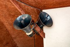 Gray horn speaker. On wooden structure of building Royalty Free Stock Photos